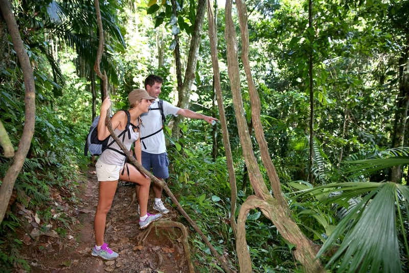 Couple on a trekking day in tropical forest